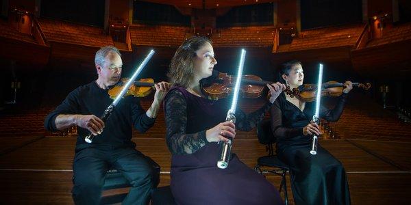 Star Wars NZFestival StarWars NZSO 01 (c) Jeff McEwan_ Pictured Dean Major, second violinist, Vanya Mateeva, second violinist and Haihong Liu 2000x1000.jpg